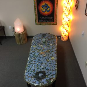 The top of the Crystal Angel Bed has many different stones.